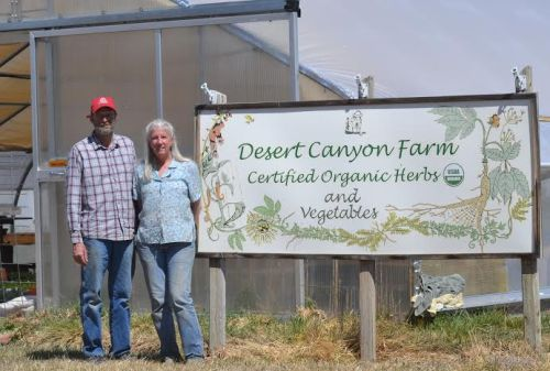 Chris and Tammi Hartung, owners and operators of Desert Canyon Farm, stand next to their farm stand store at 1270 Field Ave. Carie Canterbury/Daily Record 4-4-16
